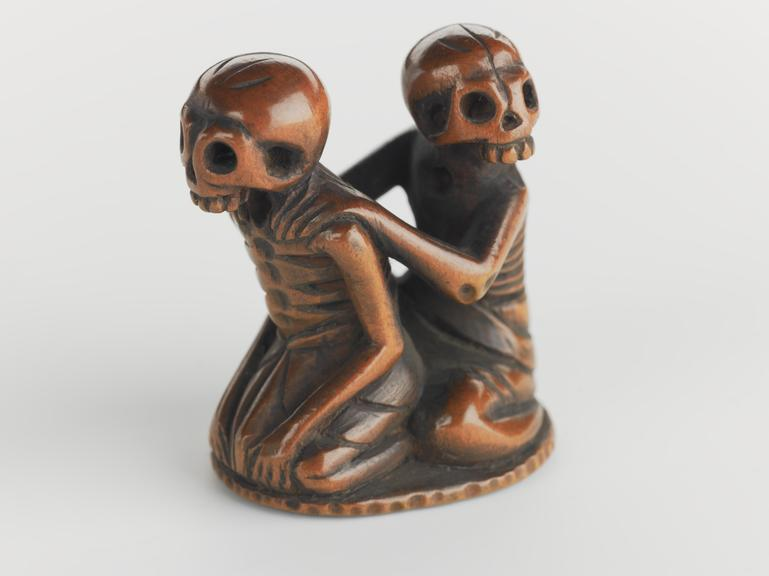 Netsuke in form of seated skeletons | Science Museum Group Collection